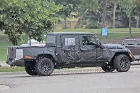 jeep truck 2 door spy photos reveal more about jeep wrangler pickup autoguide com news