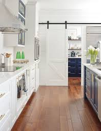 barn door for kitchen cabinets omega cabinetry white kitchen with sliding barn door