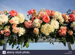 flowers on a trellis at a wedding ceremony cape cod