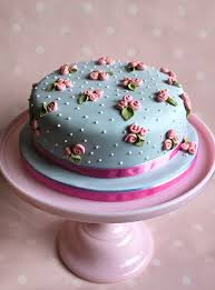 turquoise wedding cake decorated with pink roses 2029651 weddbook