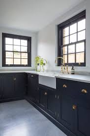 black kitchen faucet kitchen floor white acrylic dining chairs light gray cabinets