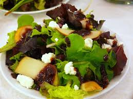 mixed green salad with pears goat cheese and a fig vinaigrette