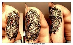 biomechanical gears tattoo on shoulder
