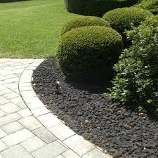 black lava rock for outdoor garden landscaping idea add texture