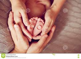baby hand rings images The hands of parents holding the feet of the baby wedding rings jpg