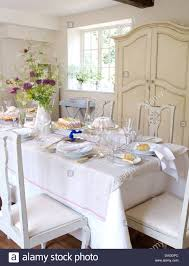 Country Dining Room by White Linen Cloth On Table Set For Lunch In White Country Dining