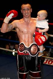 boxer dog in boxing gloves two year old boxer jacob jack davies can throw incredible