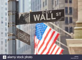 Us Flags Com Wall Street Sign Near Stock Exchange With Us Flags Financial