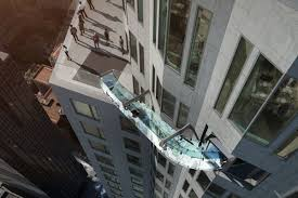 glass floor tallest tower in the west will have a glass slide stuck to the