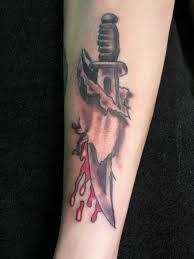 tattoo for men in hand 35 knife and dagger tattoo designs
