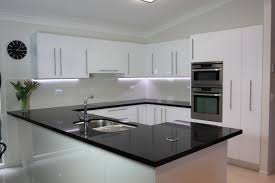 white and black kitchen ideas black benchtop white cupboards classic style that never dates