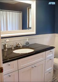Blue And Black Bathroom Ideas by Bathroom Blue Walls Huge Mirror Black Counter On White Cabinet