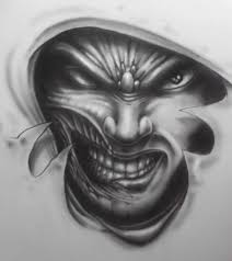evil demon face tattoo design photos pictures and sketches