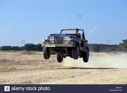 jeep rubicon offroad jumping offroad car jeep wrangler stock photo royalty free image