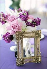 Picture Frame Centerpieces by Maybe Not These Ones Exact But I Like The Idea Of Gold Picture