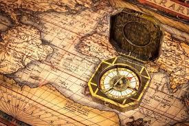 vintage pirate compass on ancient map stock photo colourbox