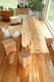 curly maple slab custom dining table with sculpted block base