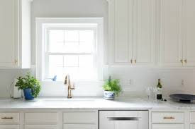 White Carrera Marble Kitchen Countertops - our white and gold kitchen makeover laura trevey home
