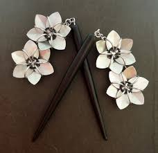 hair sticks pair of black hair sticks with two silver flowers hs black 2 slvr