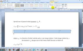 how to insert a right aligned caption next to an equation