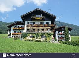 pretty houses three pretty houses with wide view in austrian tirol stock photo