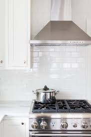 kitchen range backsplash beautiful white kitchen features a stainless steel mounted to