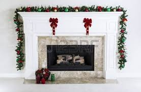 gas fireplace decorated with ornaments candles