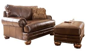 leather chair and a half recliner with ottoman for living room decoration and decorative pillows for