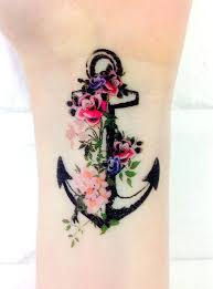 flowers and anchor wrist tattoo tattoomagz