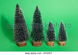 small artificial christmas trees on sale at a garden centre in the