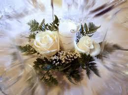 composizione di candele centrotavola matrimonio con candele e passaro sposa pinella