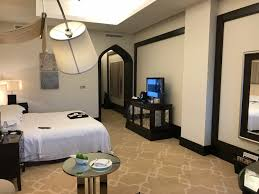 Bedroom With Bed In Middle Of Room Hotel Review An Astor Room At The St Regis Doha In Qatar