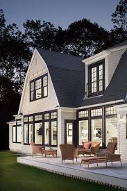 transitional windows exterior beach style with oversized window