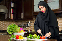 femme qui cuisine child in the kitchen with his stock image image of