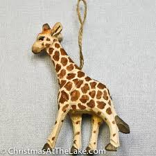 wooden giraffe ornament at the lake