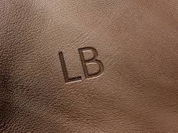 texture for logo feminine upmarket logo design for nirmal banerjee by nur solikh