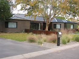 architecture ranch style house with small garage and beautiful