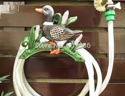 vintage cast iron wall mounted hose holder frog hose hanger