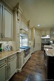 white antiqued kitchen cabinets pin by bristol on kitchens antique white kitchen