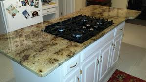 granite countertop on kitchen island with glass top gas cooktop granite countertop on kitchen island with glass top gas cooktop and telescoping downdraft