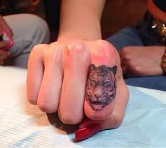 finger tattoo lioness beautiful tiger tattoo ideas best tattoo 2015 designs and ideas