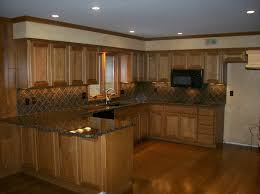brown oak kitchen cabinets combined black counter top and tile