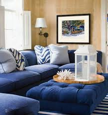 cottage living room with navy blue sectional sofa and ottoman blue