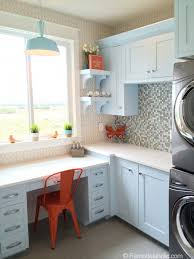 how fun is this colorful laundry room with a desk area too the