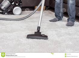 how to vacuum carpet a man cleans the carpet with a vacuum cleaner stock image image