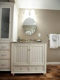 rustic bathroom vanity with oval mirror using brushed nickel