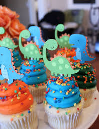 dinosaur cupcakes dinosaur cupcake toppers lime green orange and turquoise blue boy