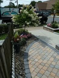 Done Right Landscaping by Walls Walkways Driveway Cobblestone Borders Sod Installation