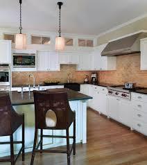 kitchen island with bar stools interior design white shaker cabinets with brick backsplash and