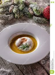 chrismas fish soup in white plate with christmas decorations